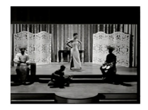 Fig.4 Maya Angelou before a curtain and ivory screens. Calypso Heat Wave. 1957.