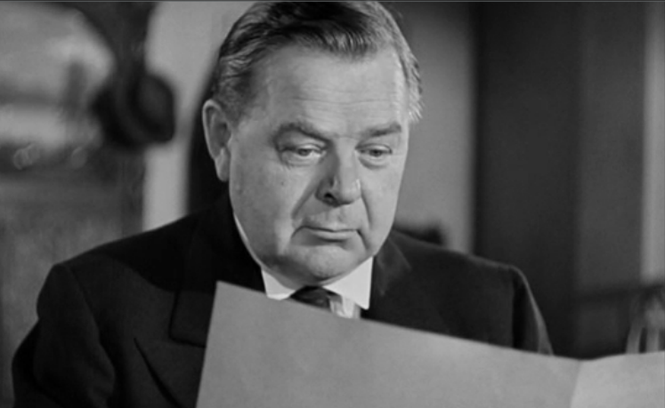 "Link to film clip in criticalcommons.org: ""'Listeningness' in HANGMEN ALSO DIE"" Fig 1: Gene Lockhart as Nazi Mole Emile Czaka in Fritz Lang's Hangmen Also Die (1943)."
