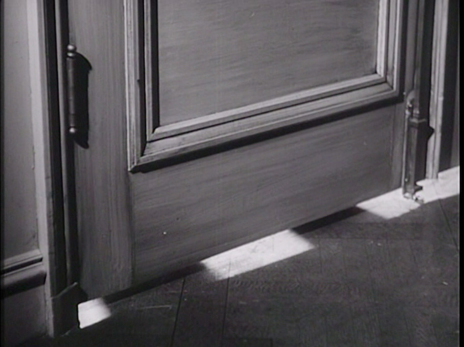 Fig 8: Inspector Gruber's shadowy ear on the other side of the door.