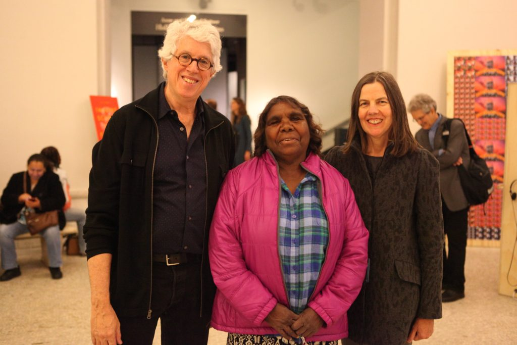 Fred Myers, Marlene Nampitjinpa Spencer, and Pip Deveson in the lobby of the American Museum of Natural History for the screening of Remembering Yayayi.  October 2014.  (The installation of Gapuwiyak Calling is in the background).  Photo credit:  Francoise Dussart.