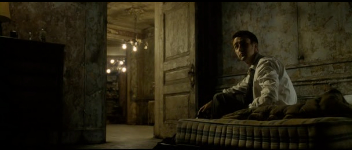 Figure 7:  Jack explores Tyler's dilapidated house in Fight Club.